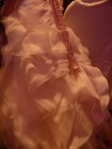 The beautiful ruffles of the back of a wedding dress