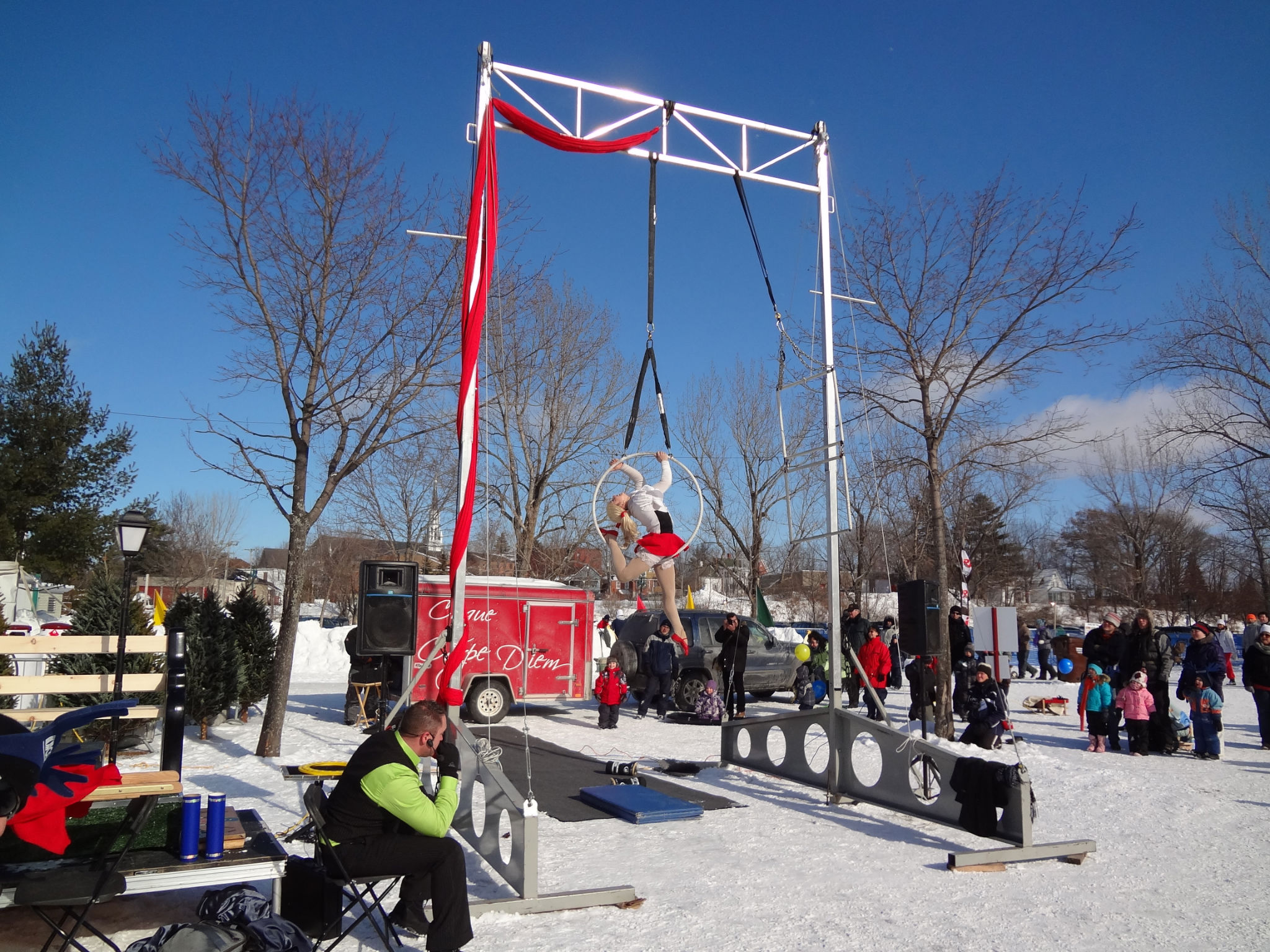 Magog Winter Festival with a gymnast rings dancing about her elevated ring