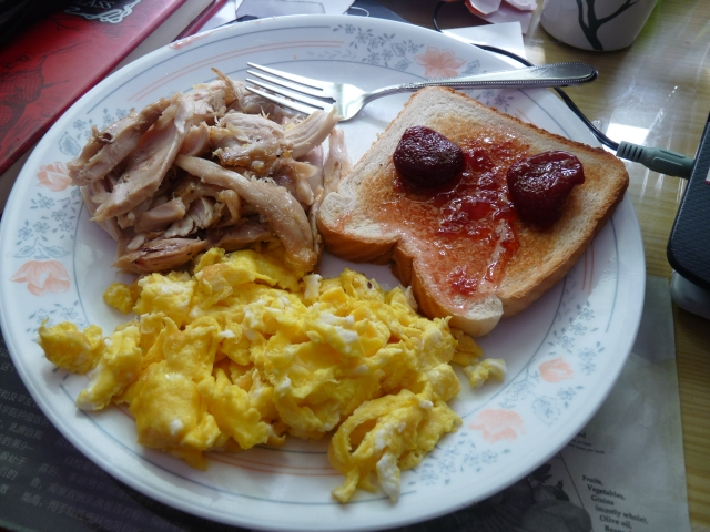 Today`s Brunch with scrambled eggs, leftover chicken from last night`s dinner and toast with strawberry jam!