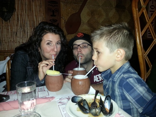 My boyfriend, her sister and her son with their Aku Aku Coconut drinks