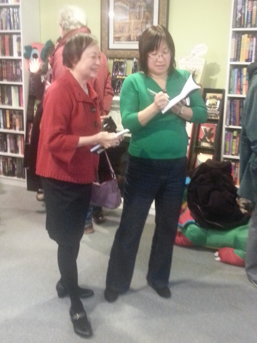 Signing books for attendees of her launch :)